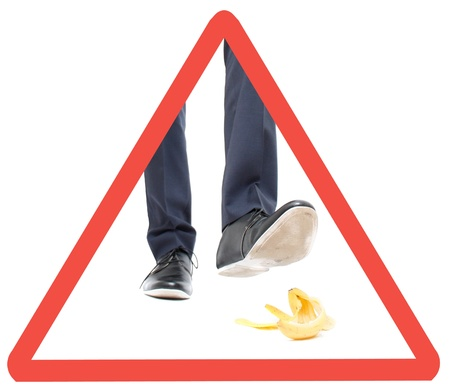 A business man about to step in banana peel Stock Photo