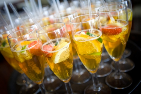 Champagne flutes with fruity punch