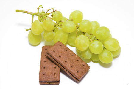 Green Grapes with Chocolate Biscuits on a White