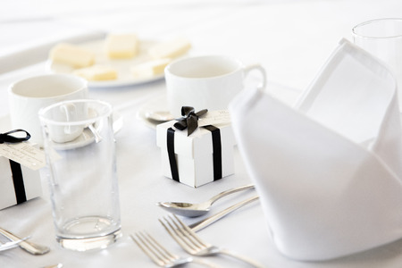 White Wedding Table with Gifts and Cutlery