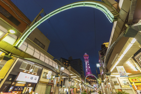 OSAKA, JAPAN - APRIL 13: Tsutenkaku Tower in Shinsekai (new world) district at night. Tsutenkaku tower were developed in 1912 with New York and Paris as models. Taken on April 13 2016.