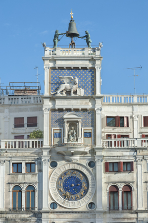 clock of the moors: Zodiac clock. Clock Tower with winged lion and two moors striking the bell - early Renaissance (1497) building in Venice, located the north side of Piazza San Marco, Italy, Europe.