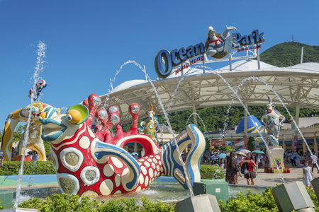 Hong Kong, China - July 24, 2016 : Tourist at the main entrance of Ocean Park Hong Kong. Ocean Park is an animal theme park exhibits such as grant panda and dolphin. It is one of the famous theme parks in Hong Kong.