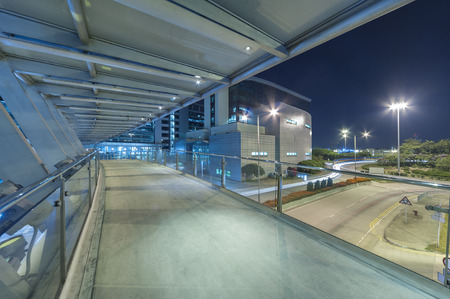 pedestrian bridge: Empty modern pedestrian walkway in midtown at night Stock Photo
