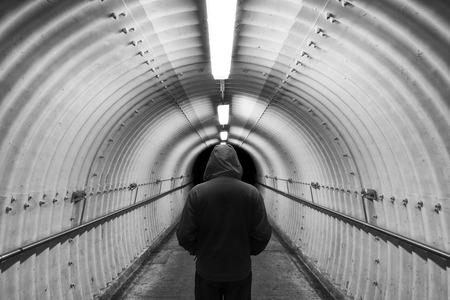 Men in tunnel Stock Photo