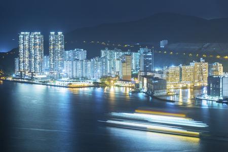 waterfront property: Harbor of Hong Kong city at night