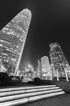 Modern office building and skyline of Hong Kong City at night