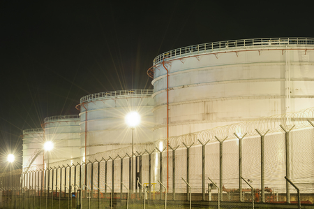 Row of oil tank at night