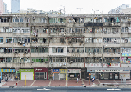 Hong Kong, China - April 13, 2013 : overcrowded old residential building in Hong Kong city