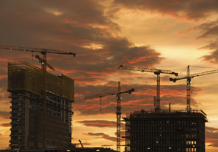 Crane in construction site under sunset