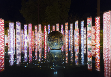 Kyoto, Japan - November 19, 2018 : light show in Kimono Forest Route in Arashiyama, Kyoto, Japan. Kimono Forest is a collection of gorgeous cylinder-shaped pillars framing the lane way and was installed as part of the renovation in 2013. Редакционное