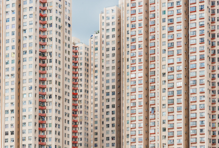 exterior of colorful high rise residential building in Hong Kong city Imagens