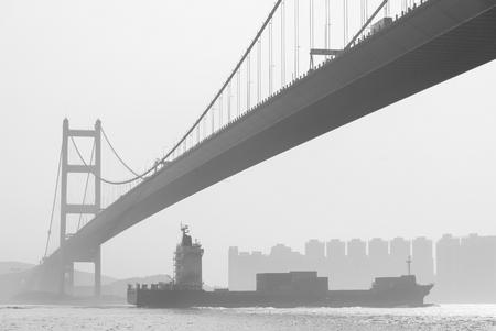 Cargo ship and Tsing Ma Bridge in Hong Kong