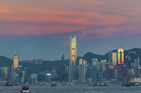 Victoria Harbor in Hong Kong city at dusk