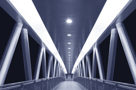 modern empty foot bridge in the dark