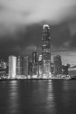 Skyline and harbor of Hong Kong city at dusk