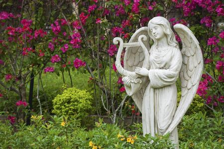 Sculpture of angel in flower garden