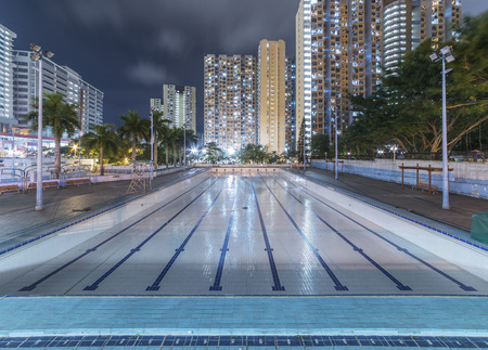 Swimming pool and high rise residential building in Hong Kong city