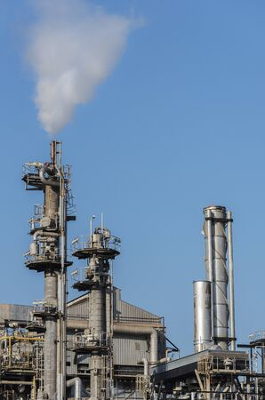 Closeup view of chimney of chemical factory