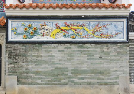 Colorful mosaic and relief in Pak Tai Temple, Cheung Chau, Hong Kong