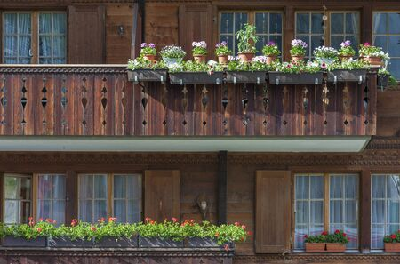 Exterior of traditional wooden house in swiss  Stock fotó