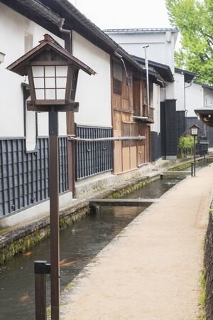 Lantern in alley of historical village Furukawa in Hida, Gifu prefecture, Japan. Old town with water canal