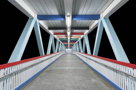 Modern empty foot bridge at night Foto de archivo