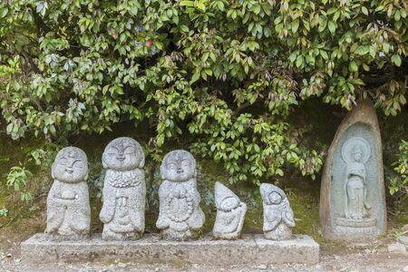 Cute Japanese Jizo sculpture on roadside in Arashiyama, Japan Stock fotó