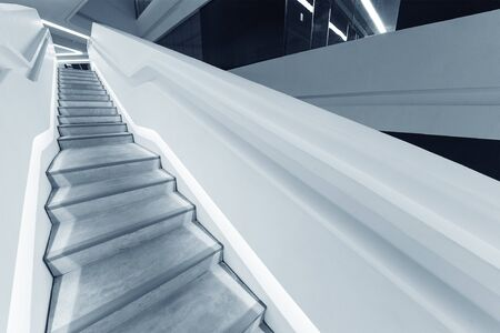 Interior view of empty futuristic stairway. Building abstract background Stock Photo
