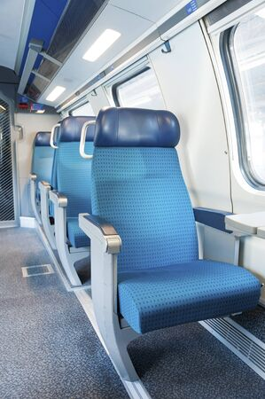 Interior view of seat in modern train. transportation background