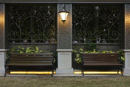 Empty wooden seat in garden at night Reklamní fotografie