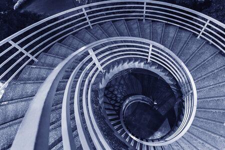 Night scene of spiral Staircase in monochrome Stock Photo