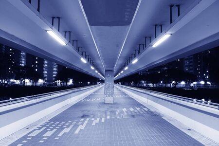 Empty foot bridge and pedestrian walkway at night