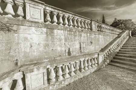Stone baroque baluster and stairway in garden Archivio Fotografico