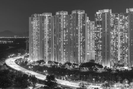 High rise residential building and highway in Hong Kong city at night