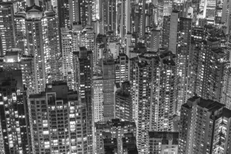 Aerial view of crowded high rise building in Hong Kong city at night Фото со стока
