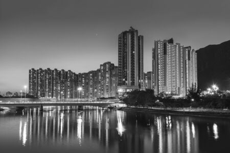 High rise residential building and mountain in Hong Kong city at dusk Фото со стока