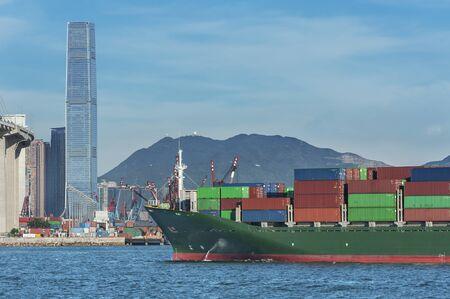 Cargo ship in Victoria Harbor in Hong Kong city