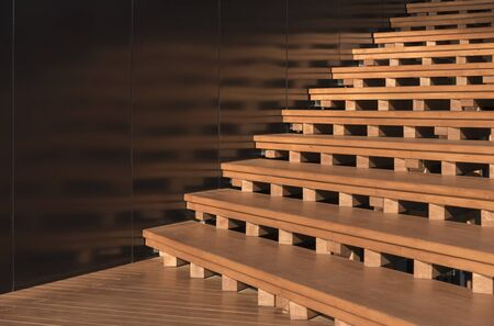 wooden stairs in detail. modern building abstract background pattern