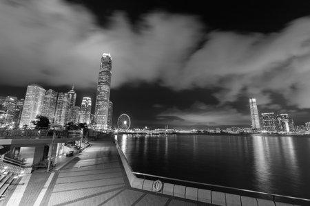 Panorama of skyline of Victoria Harbor of Hong Kong city at night Редакционное