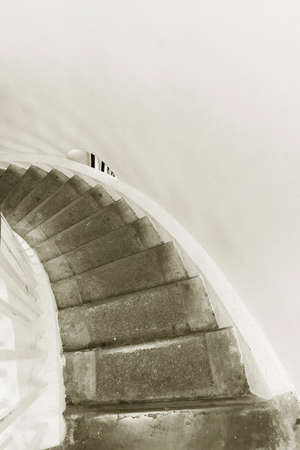Interior view of old spiral staircase. Building abstract background