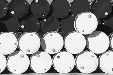Oil barrel stacked in row. Industrial background