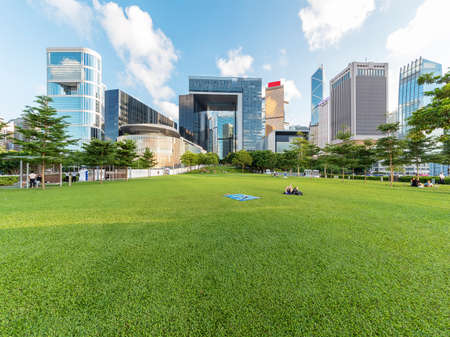 Public park and skyline in downtown district of Hong Kong city