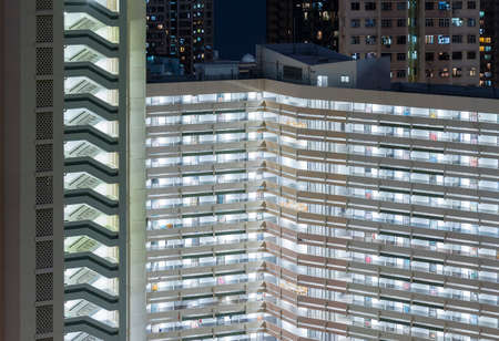 Night scene of exterior of high rise residential building of public estate in Hong Kong city