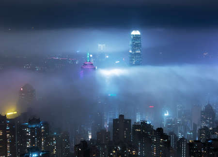 Skyline of Victoria harbor of Hong Kong city in fog 版權商用圖片