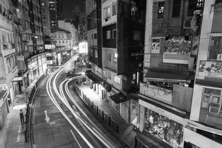 Hong Kong, China - November 26, 2020 : Traffic in old street of central district of Hong Kong city at night
