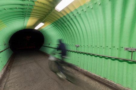 biker riding on bicycle in tunnel Фото со стока