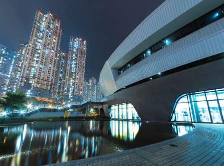 Modern architecture in Park and high rise residential building in Hong Kong city at night Фото со стока