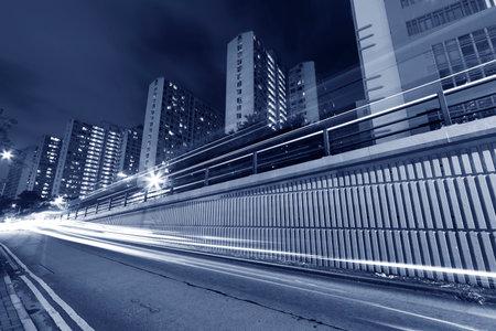 traffic in urban city at night Фото со стока