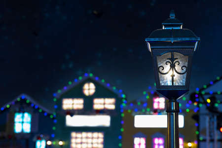Classic streetlight with blurred old town background